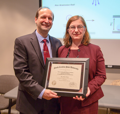 Drs. Orlin and Anka Velev with Reynolds Award Plaque