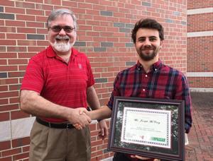 Joseph McCaig receives Praxair TA Award