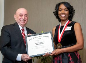 Ms. Steffanie Easter receives award from Dean Martin-Vega