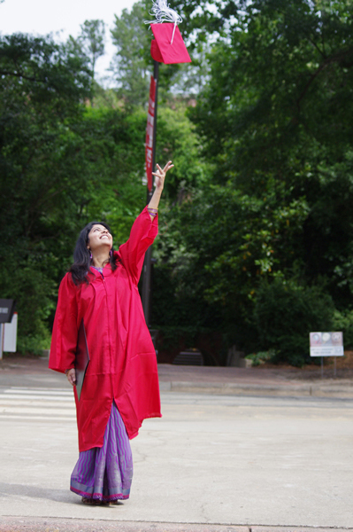 Student tossing her graduation cap