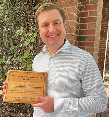 Professor Matt Cooper Holding Corcoran Award